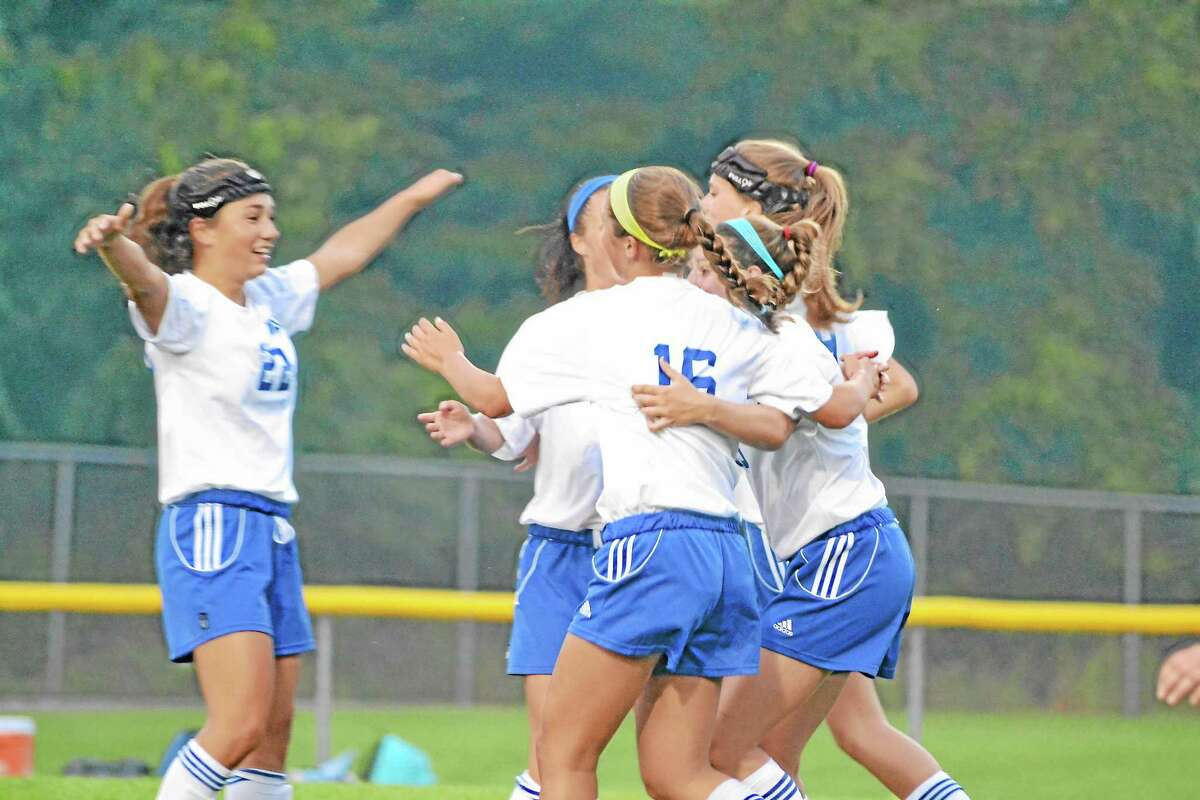 Julia Pearson celebrates with her team after scoring the first goal of the game in Lewis Mills 7-0 win against Shepaug.