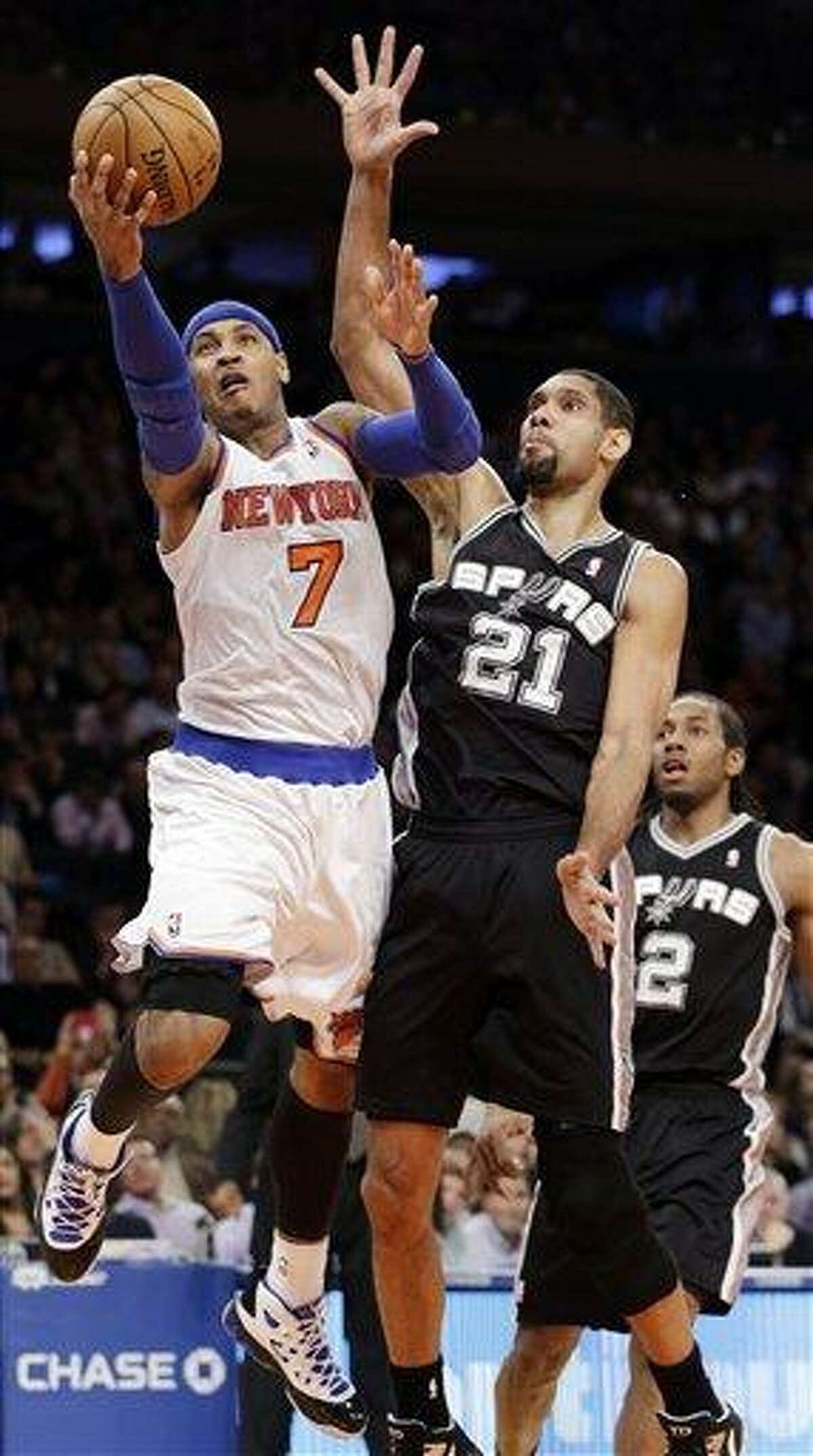 New York Knicks forward Carmelo Anthony (7) shoots a layup against San Antonio Spurs forward Tim Duncan (21) in the second half of their NBA basketball game at Madison Square Garden in New York, Thursday, Jan. 3, 2013. The Knicks won 100-83. (AP Photo/Kathy Willens)