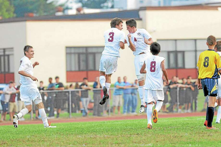 Torrington's John McCarthy (4) celebrates his goal with Nick Mancini (3) who assisted on the goal. Photo: Laurie Gaboardi—Register Citizen