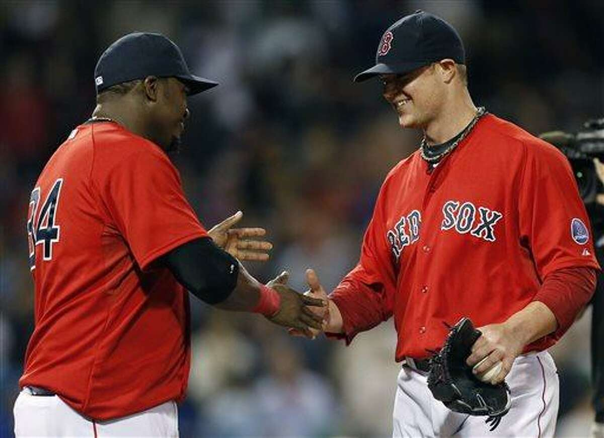 Boston Red Sox's David Ortiz, left, and Jon Lester celebrate after beating the Toronto Blue Jays 5-0 in a baseball game in Boston, Friday, May 10, 2013. Lester pitched nine innings and gave up one hit. AP Photo/Michael Dwyer)
