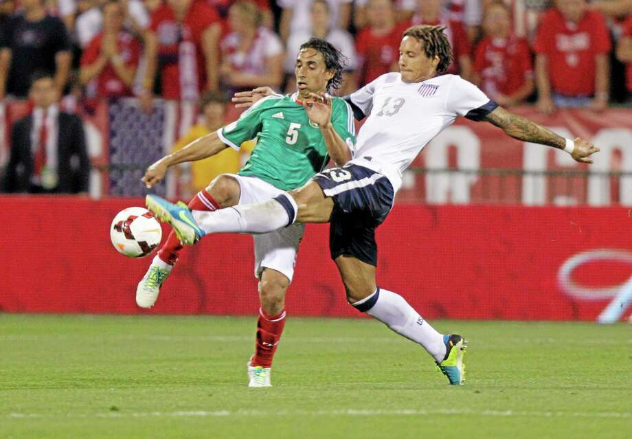 The United States' Jermaine Jones, right, and Mexico's Fernando Arce scramble for a loose ball during the second half of a World Cup qualifying soccer match Tuesday. Photo: Jay LaPrete  — The Associated Press  / FR52593 AP
