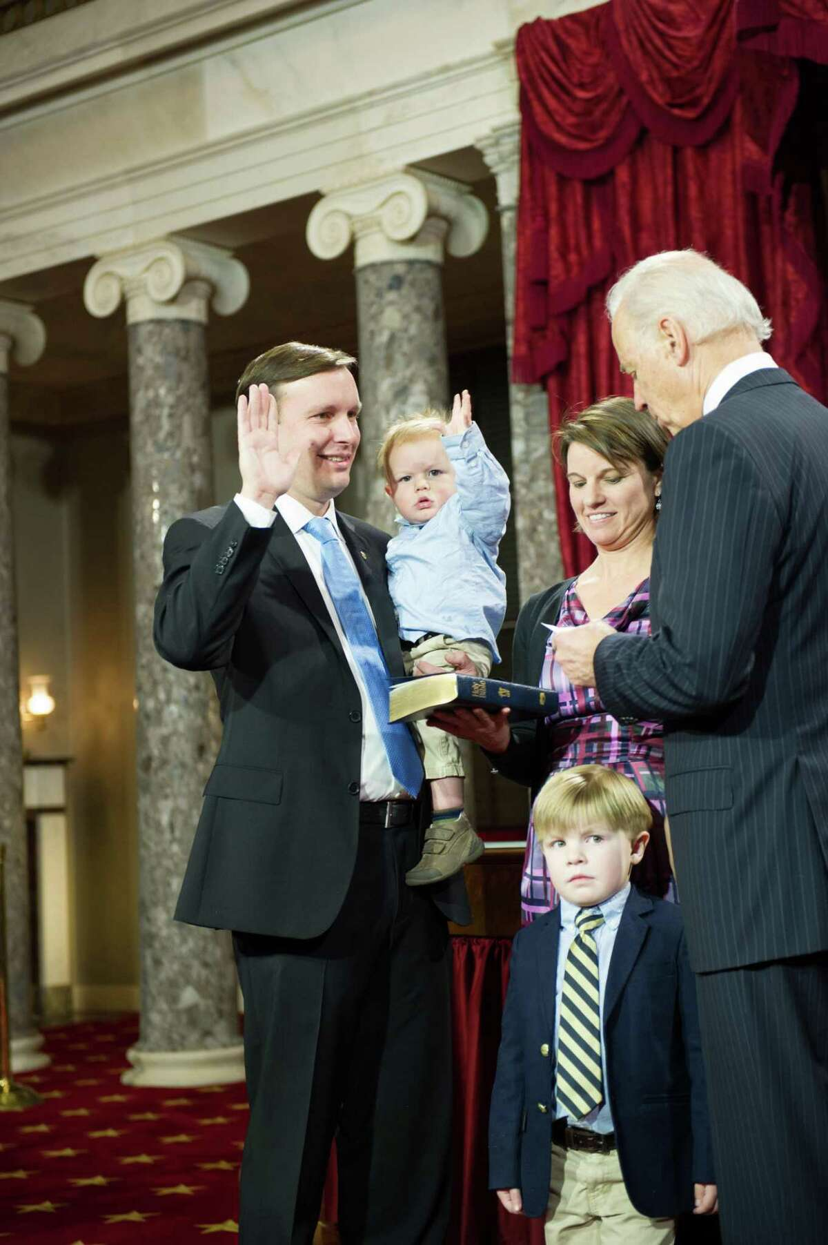Connecticut's new U.S. Senator Murphy is sworn in with some help from his son Rider. With Murphy is Vice President Joe Biden, Cathy Holahan; and Owen Murphy, 4.(contributed photo)