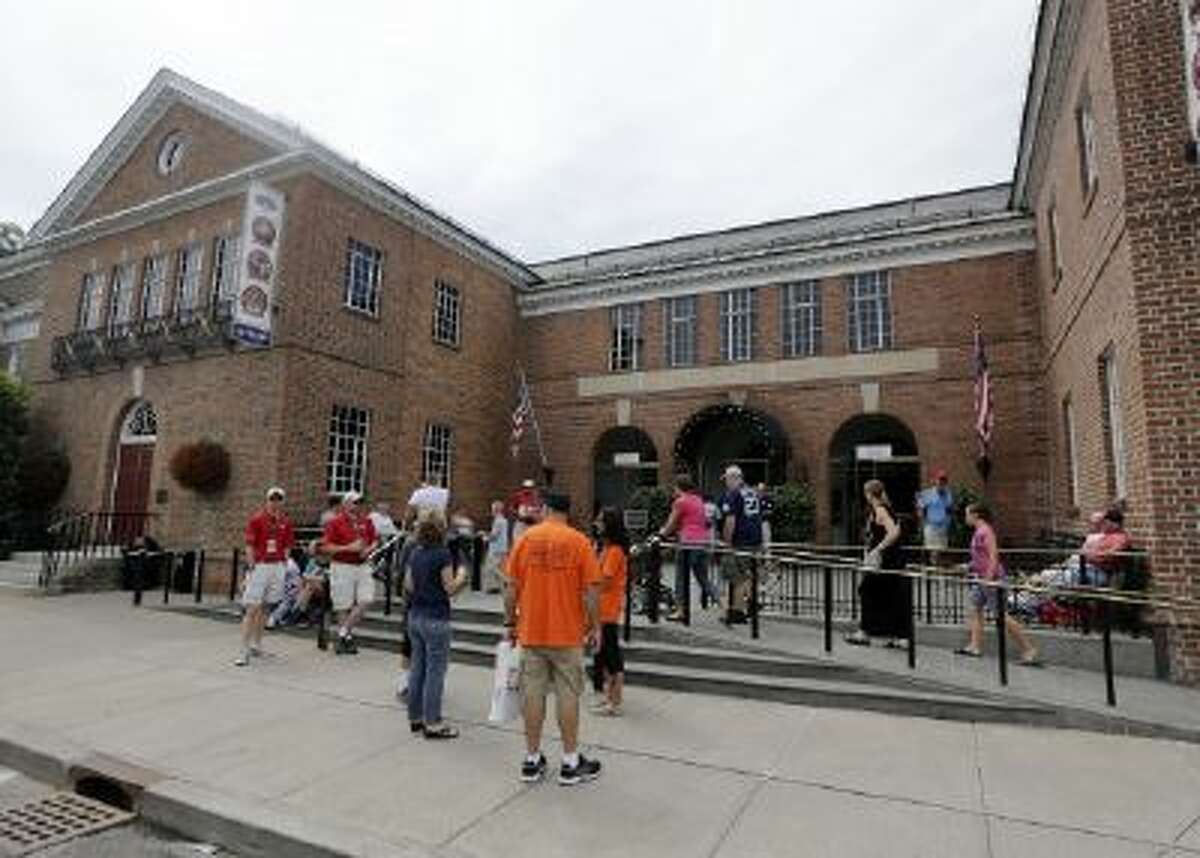 Fans gather outside the baseball Hall of Fame in Cooperstown, N.Y.