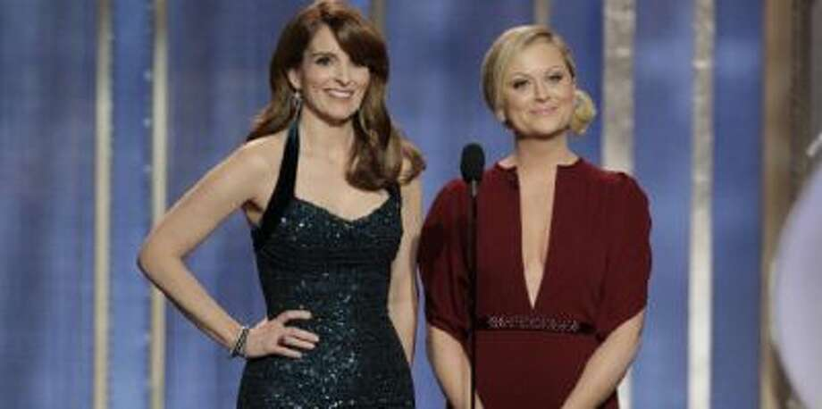 Tina Fey and Amy Poehler host the 70th Annual Golden Globe Awards in 2013