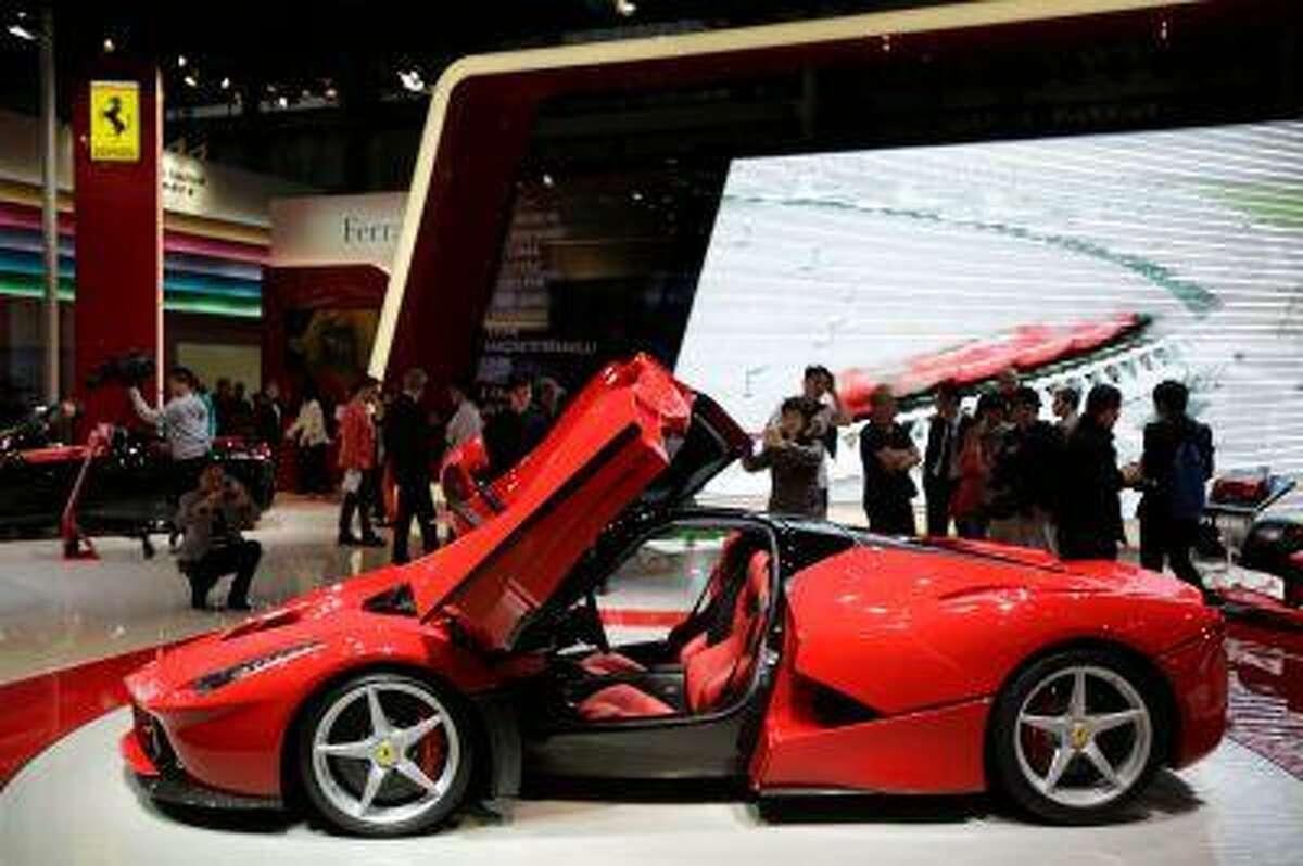 Ferrari LaFerrari is displayed at the Shanghai International Automobile Industry Exhibition (AUTO Shanghai) media day in Shanghai, China Saturday, April 20, 2013. (AP Photo/Eugene Hoshiko)
