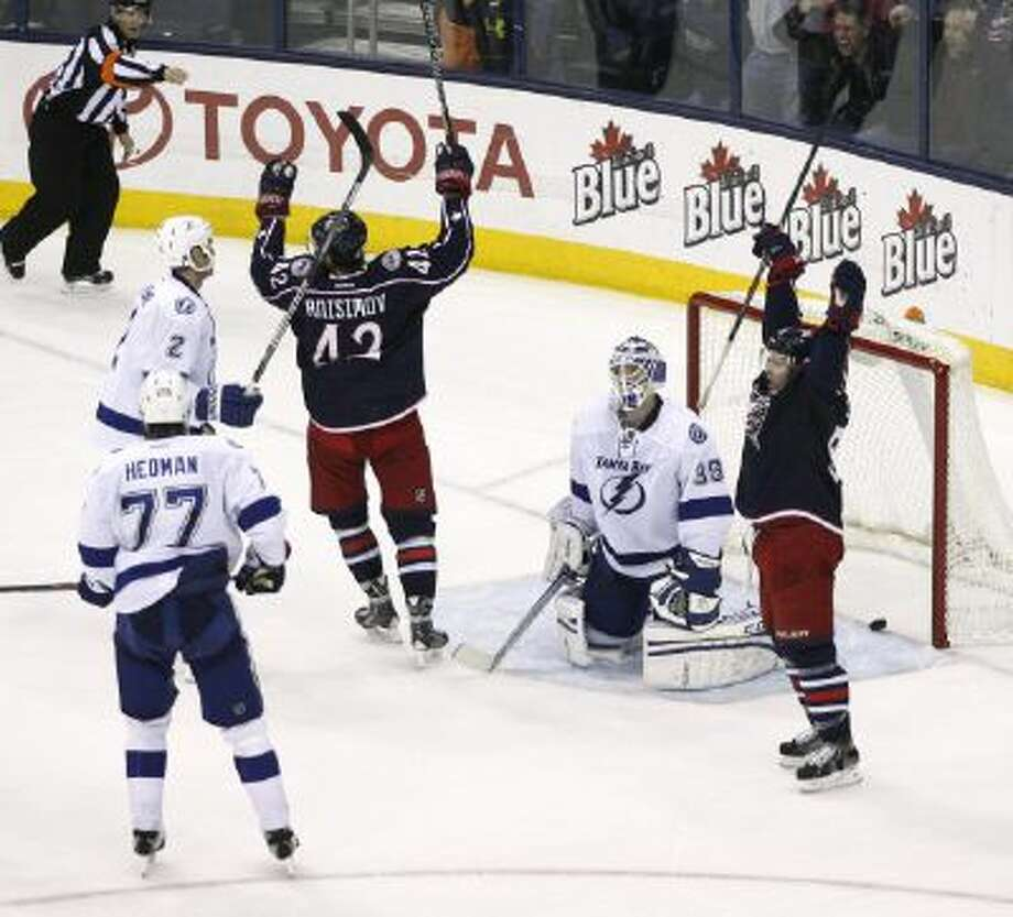 The Columbus Blue Jackets celebrate Jack Johnson's game-winning goal against the Tampa Bay Lightning, Jan. 13, 2014.