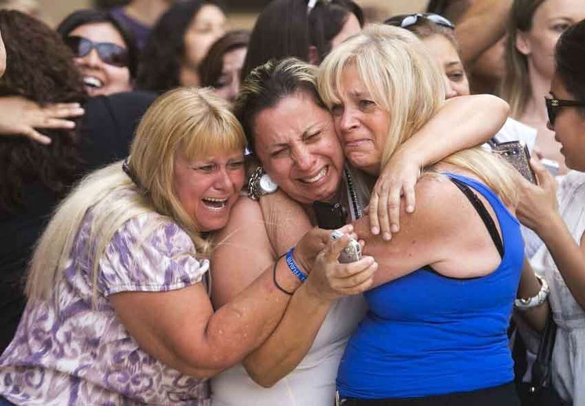 From left, Kathy Brown, of Paradise Valley, Virginia Aguiar, of Scottsdale, Jane Crook, of Scottsdale, react to a guilty verdict for Jodi Arias, Wednesday, May 8, 2013, outside of Maricopa County Superior Court in Phoenix. Arias was convicted of first-degree murder in the gruesome killing of her one-time boyfriend in Arizona after a four-month trial that captured headlines with lurid tales of sex, lies, religion and a salacious relationship that ended in a blood bath. (AP Photo/The Arizona Republic, David Wallace)
