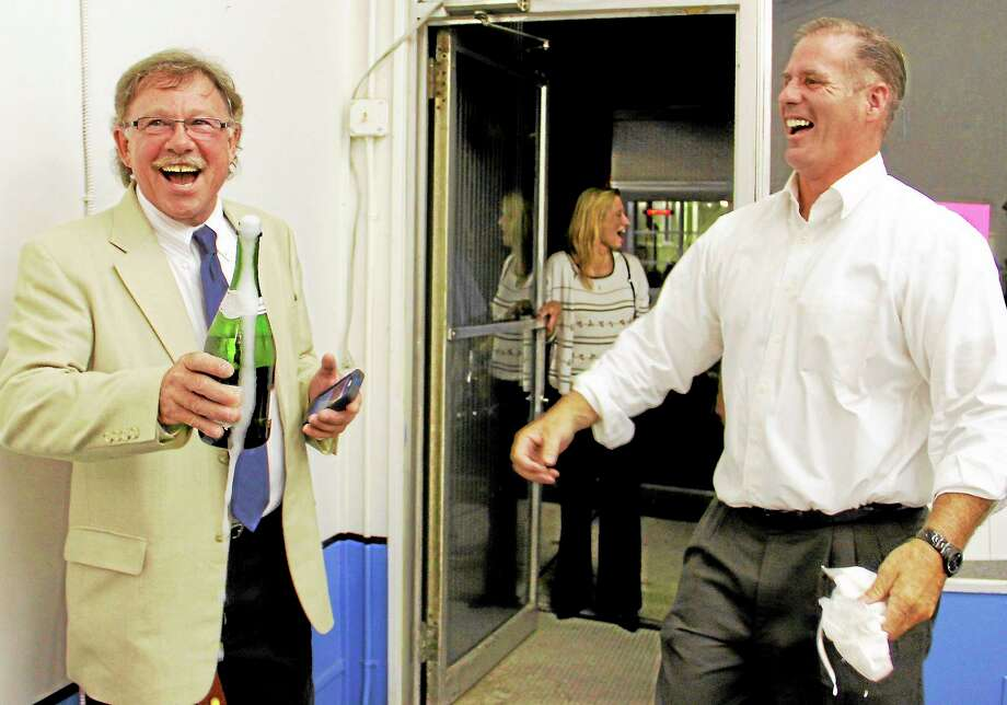 George Craig, left, celebrates with Chris Cook, right, at the Democratic Town Committee headquarters on Water Street Tuesday after learning of Craig's victory in Torrington's Democratic mayoral primary over Collin Good with an unofficial vote total of 373-327. Photo: Esteban L. Hernandez—Register Citizen