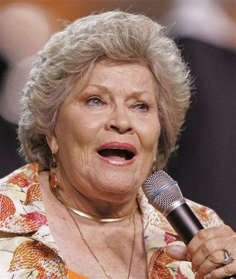 "FILE - In this Sept. 26, 2009 file photo, singer Patti Page performs the Tennessee Waltz during halftime of a NCAA college football game Tennessee and Ohio in Knoxville, Tenn. Page, who made ""Tennessee Waltz"" the third best-selling recording ever, has died. She was 85. (AP Photo/Wade Payne, file) Photo: AP / FR23601 AP"