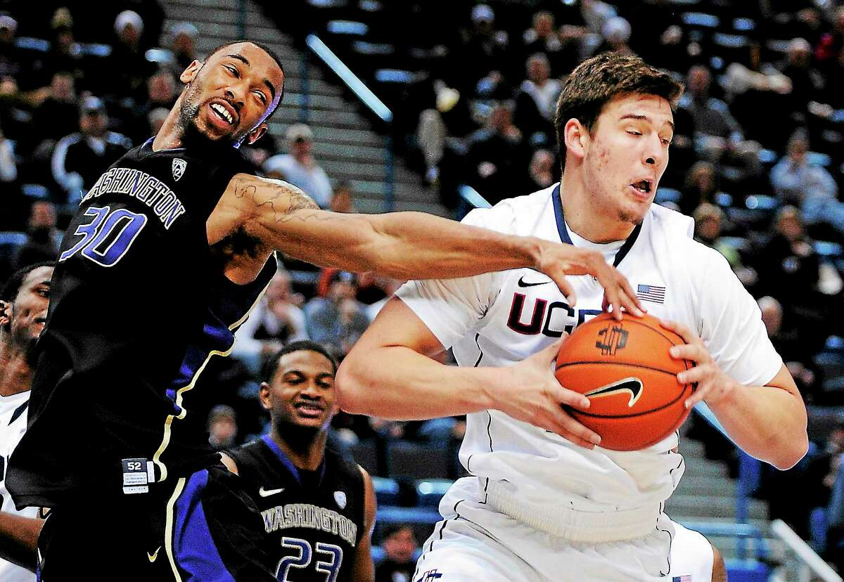 For the second time in the span of six months, UConn's Tyler Olander, right, has run into trouble.