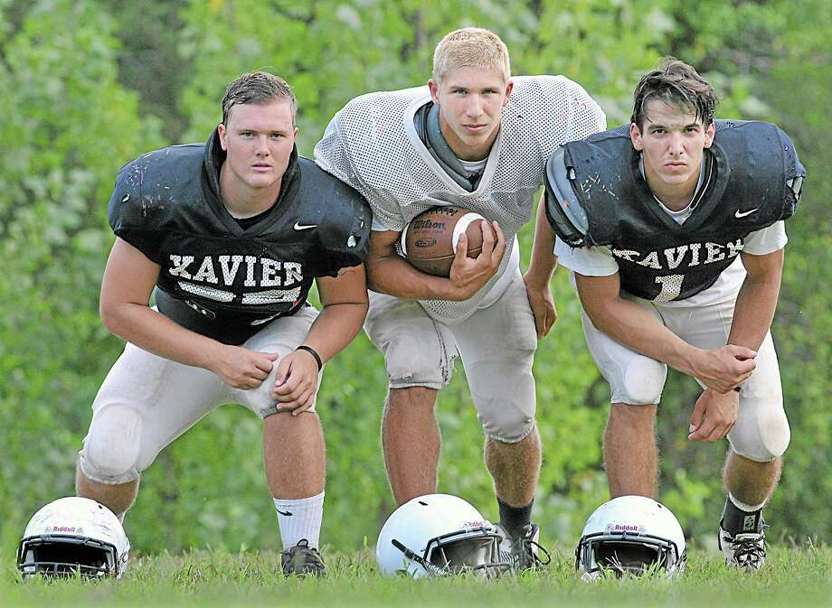 Led by senior captains Will Garrity, left, Joe Carbone, center and Andrew Meoli, the Xavier football team is No. 1 in the Register preseason football poll. Photo: Catherine Avalone — The Middletown Press  / TheMiddletownPress