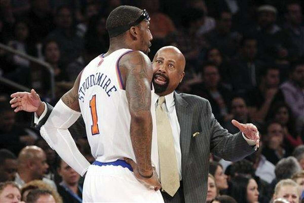 New York Knicks head coach Mike Woodson talks to Amare Stoudemire (1) during the first half of an NBA basketball game against the Philadelphia 76ers, Sunday, Feb. 24, 2013, at Madison Square Garden in New York. The Knicks won 99-93. (AP Photo/Mary Altaffer,