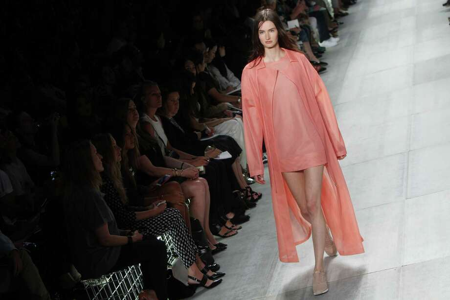 A model presents fashion by Lacoste during the Mercedes-Benz Fashion Week Spring 2014 collections on September 7, 2013 in New York. AFP PHOTO/Mehdi Taamallah Photo: AFP / AFP ImageForum