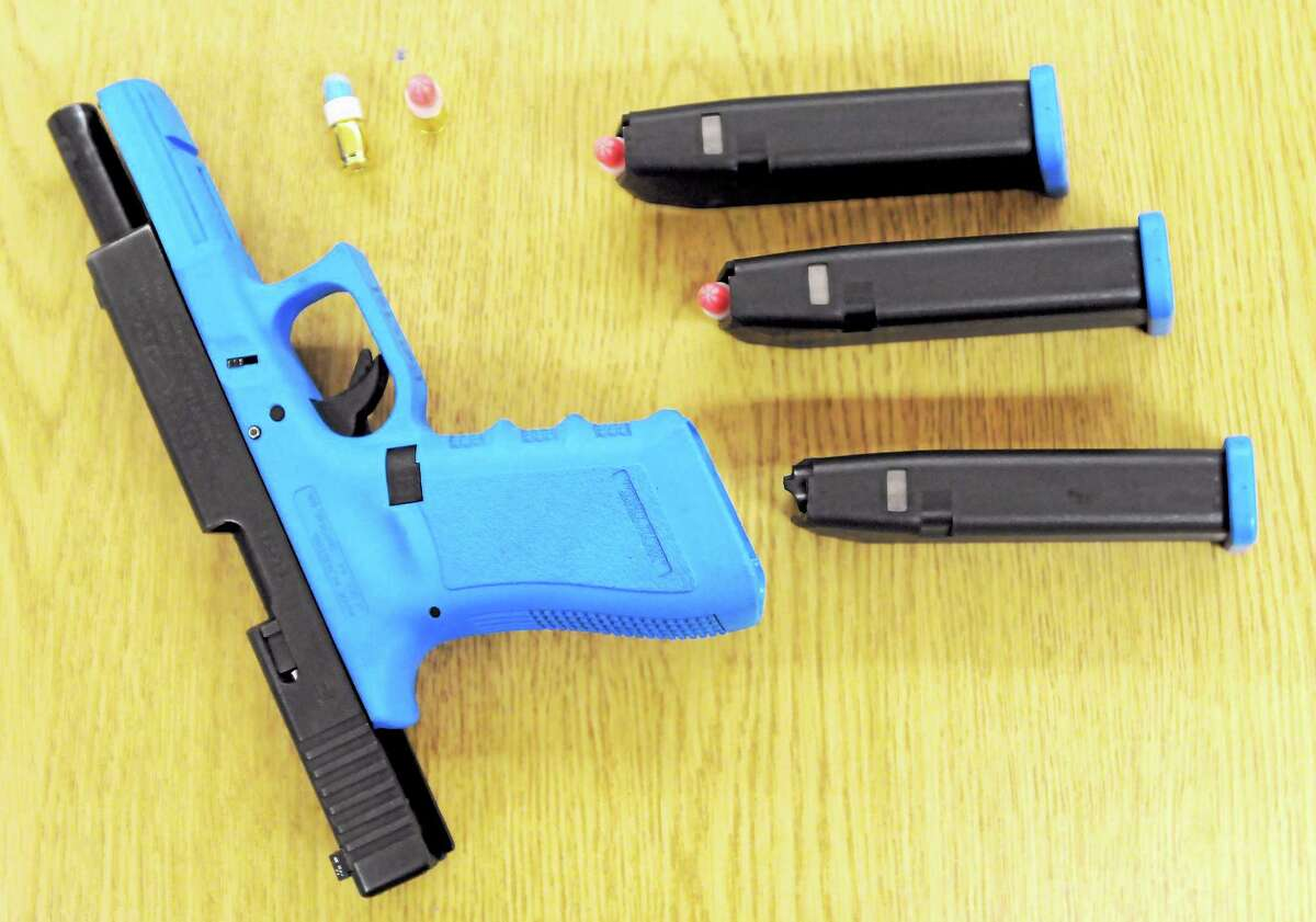 """A Glock pistol with """"simunitions"""" ammunition that the Bristol Police Department uses with the Canadian Academy of Practical Shooting system."""