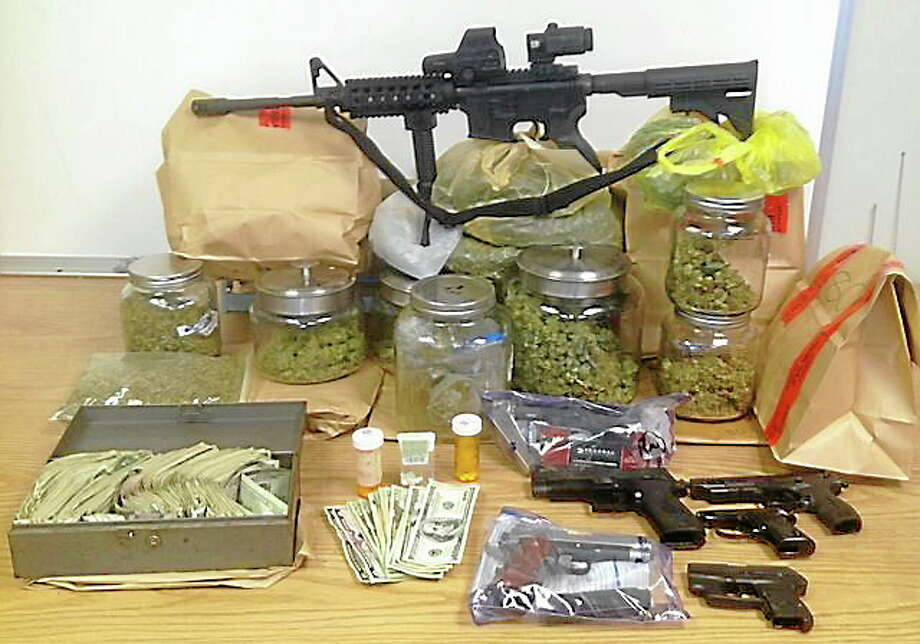 Police said they found marijuana, guns and prescription pills during a search of 27 Sylvan Lake Road on Sunday, Sept. 8, 2013. Photo: Journal Register Co.