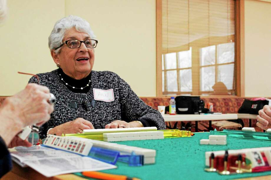 Ann Aust, 80, played mahjong during a local tournament to raise money for the Litchfield Community Center Friday. Photo: Shako Liu—The Register Citizen