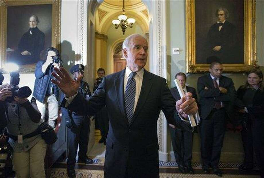 Vice President Joe Biden speaks to reporters after a Senate Democratic caucus meeting about the fiscal cliff, on Capitol Hill on Monday, Dec. 31, 2012 in Washington. (AP Photo/Alex Brandon) Photo: AP / AP