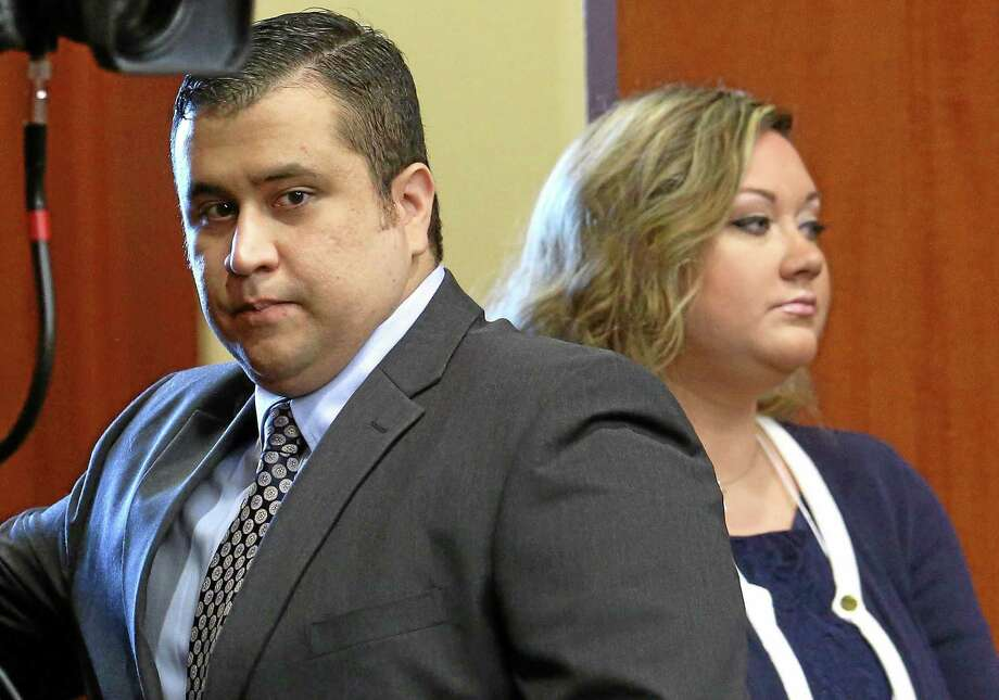 In this June 24, 2013 file photo, George Zimmerman, left, arrives in Seminole circuit court, with his wife Shellie, in Sanford, Fla. Shellie Zimmerman called police on Monday, Sept. 9, 2013, saying her husband threatened her and her dad with a gun. Zimmerman was acquitted in the 2012 shooting death of Trayvon Martin. (AP Photo/Orlando Sentinel, Joe Burbank, Pool, File) Photo: AP / Pool Orlando Sentinel