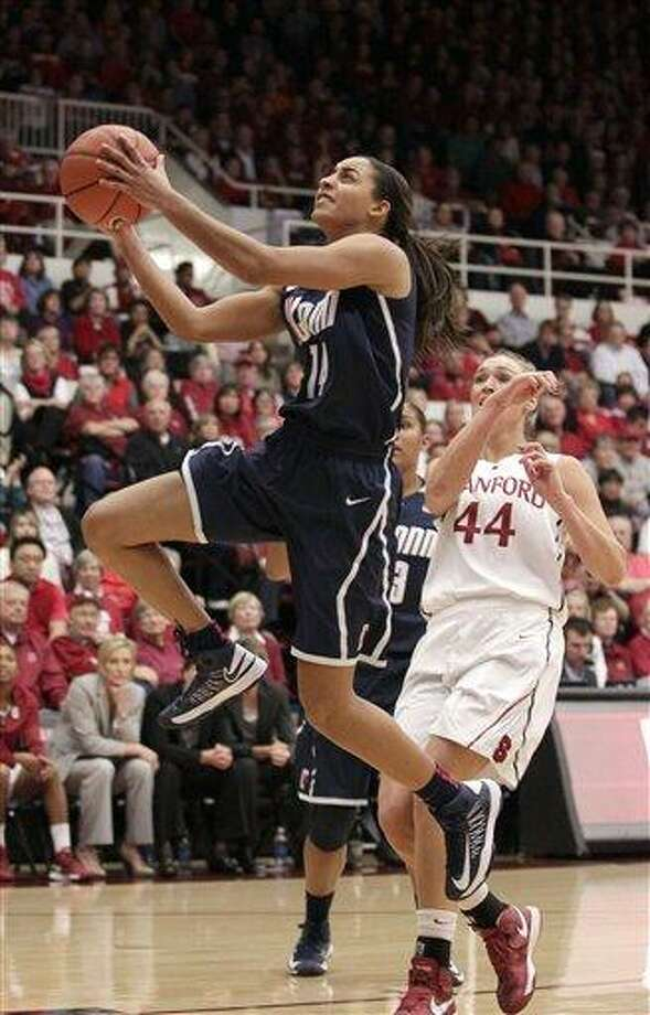 Connecticut guard Bria Hartley (14) drives to the basket past Stanford forward Joslyn Tinkle (44) during the first half of an NCAA college basketball game in Stanford, Calif., Saturday, Dec. 29, 2012. (AP Photo/Tony Avelar) Photo: ASSOCIATED PRESS / AP2012
