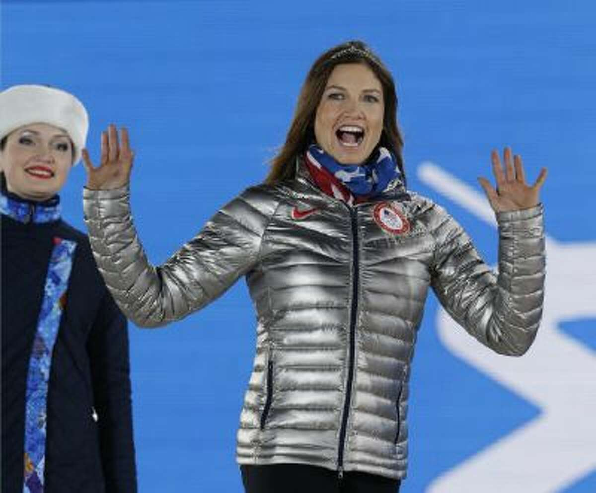 Women's super combined bronze medalist Julia Mancuso of the United States waves during the medals ceremony at the 2014 Winter Olympics, Monday in Sochi, Russia.