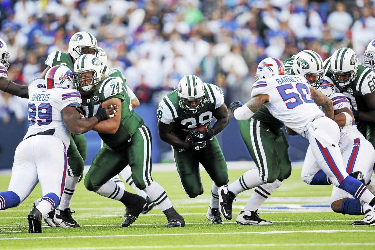 New York Jets fullback John Conner (38) runs against the Buffalo Bills during a 2011 game in Orchard Park, N.Y.
