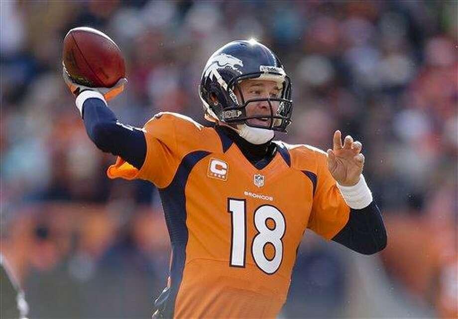 Denver Broncos quarterback Peyton Manning throws a pass in the first quarter of an NFL football game against the Kansas City Chiefs, Sunday, Dec. 30, 2012, in Denver. (AP Photo/Joe Mahoney) Photo: ASSOCIATED PRESS / AP2012