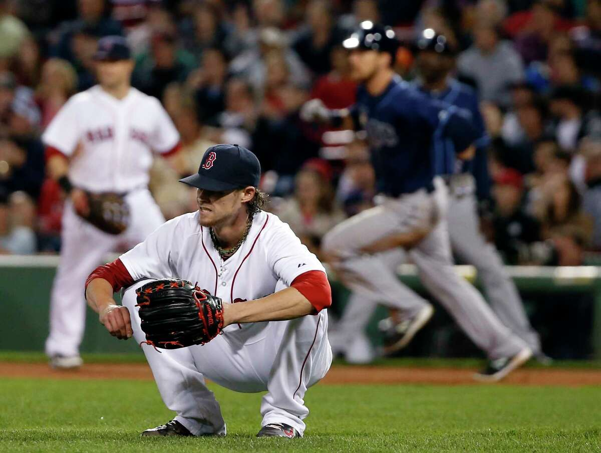 Red Sox starting pitcher Clay Buchholz reacts after giving up a two-run double to the Tampa Bay Rays' Ben Zobrist in the eighth inning of a Sept. 23 game at Fenway Park in Boston.