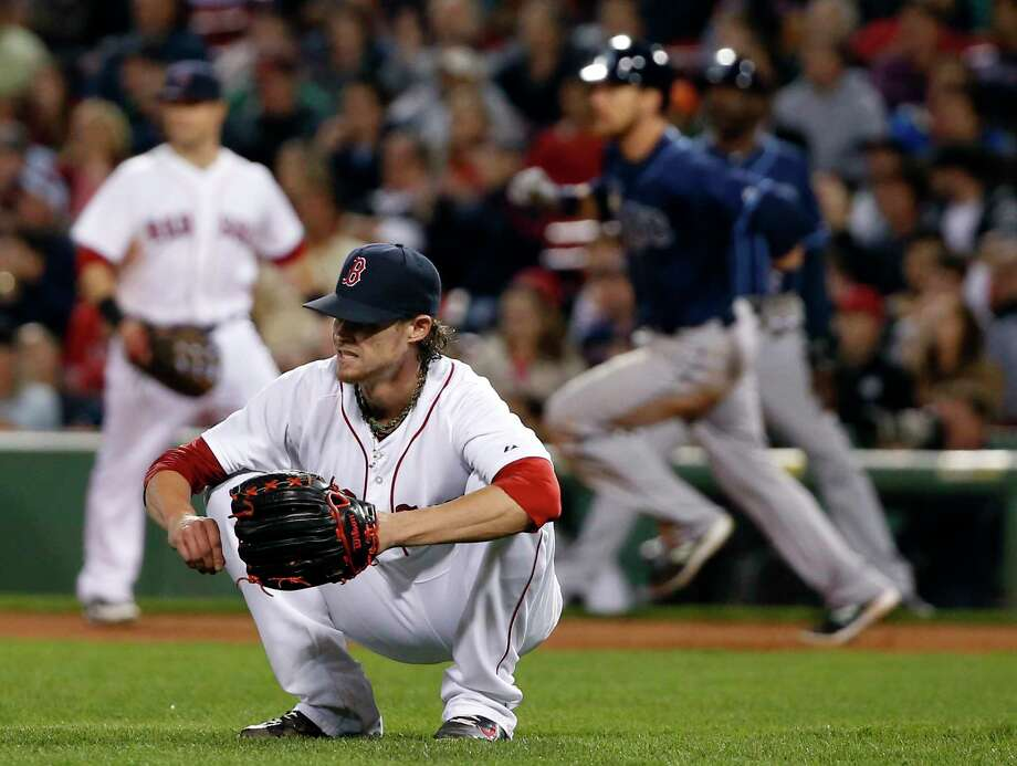 Red Sox starting pitcher Clay Buchholz reacts after giving up a two-run double to the Tampa Bay Rays' Ben Zobrist in the eighth inning of a Sept. 23 game at Fenway Park in Boston. Photo: Elise Amendola — The Associated Press  / AP
