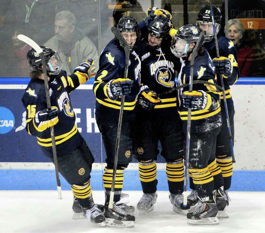 Quinnipiac players celebrate after taking a 3-0 lead over Yale in Friday's game. The Bobcats won 4-0. Photo: Arnold Gold — Register