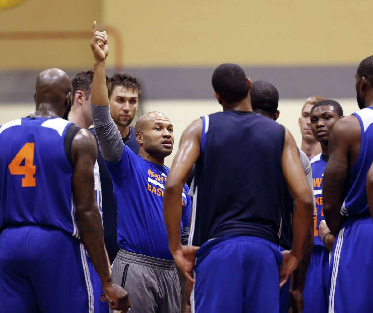 New York Knicks coach Derek Fisher talks to his players during practice at the team's training camp at the U.S. Military Academy in West Point, N.Y., on Tuesday.