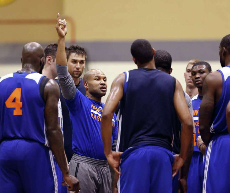 New York Knicks coach Derek Fisher talks to his players during practice at the team's training camp at the U.S. Military Academy in West Point, N.Y., on Tuesday. Photo: Mike Groll — The Associated Press  / AP