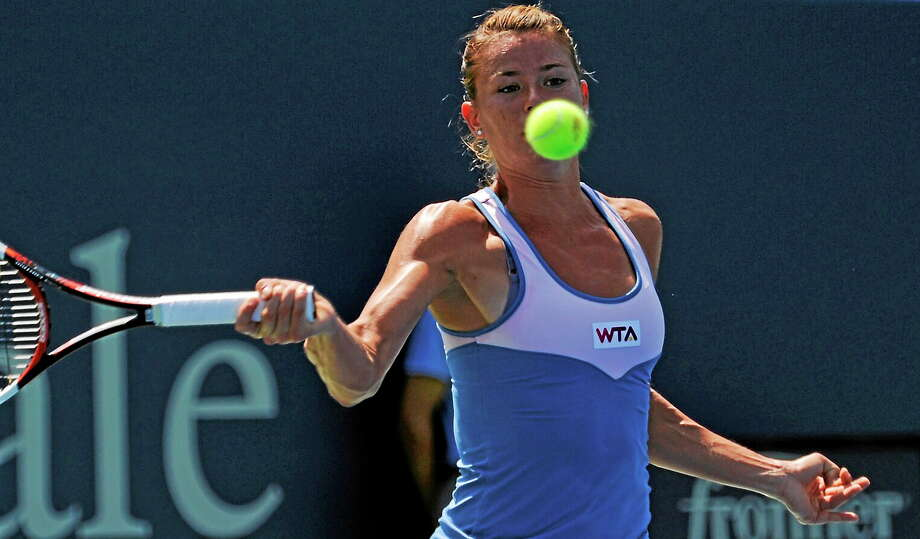 Camila Giorgi watches the ball come in during her match with Caroline Wozniacki on Wednesday afternoon at the Connecticut Open. Photo: Bob Child — For The Register  / New Haven Register