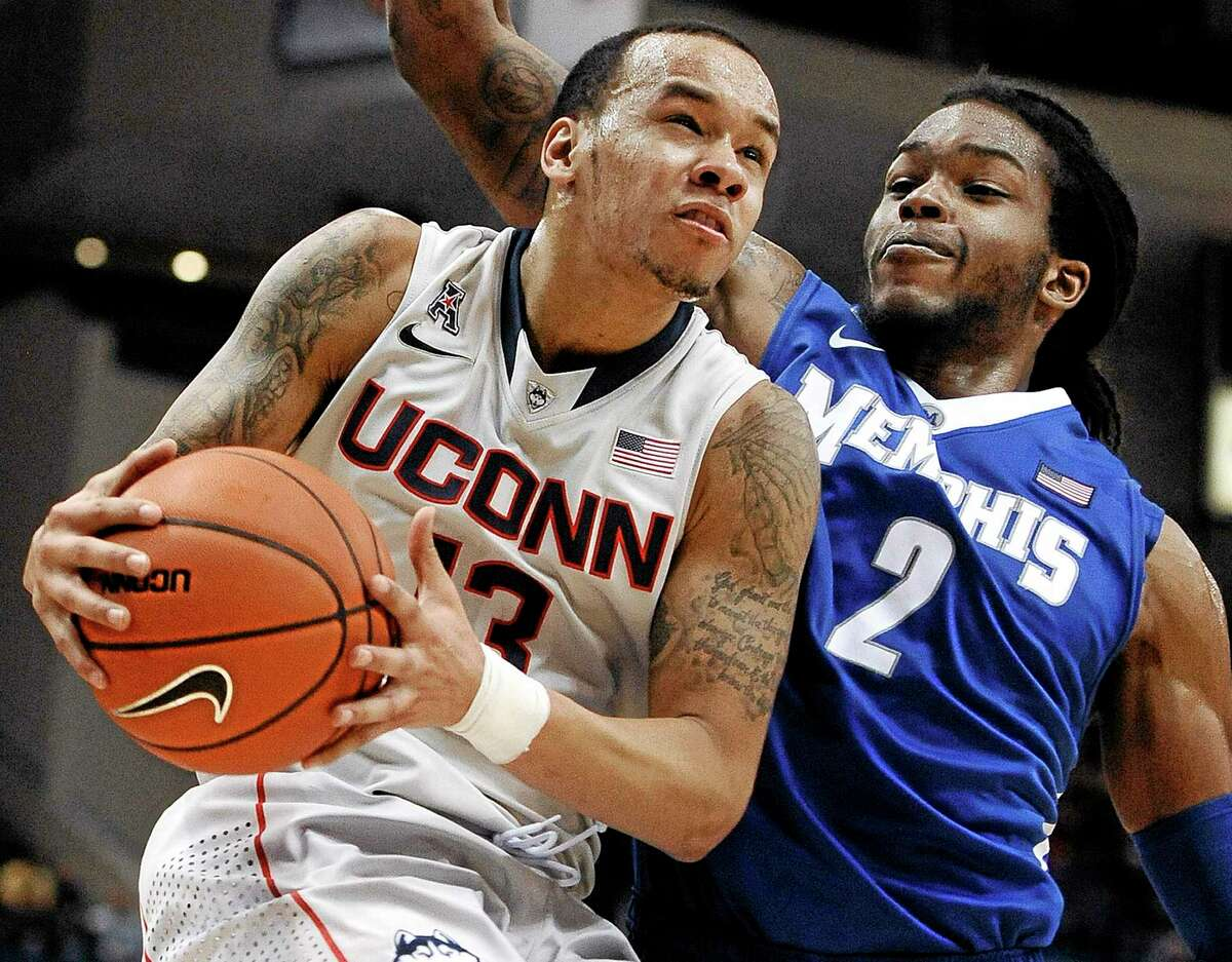 Shabazz Napier drives to the basket as Memphis' Shaq Goodwin defends during the second half of No. 24 UConn's 86-81 overtime win over the 20th-ranked Tigers on Saturday at the XL Center in Hartford.