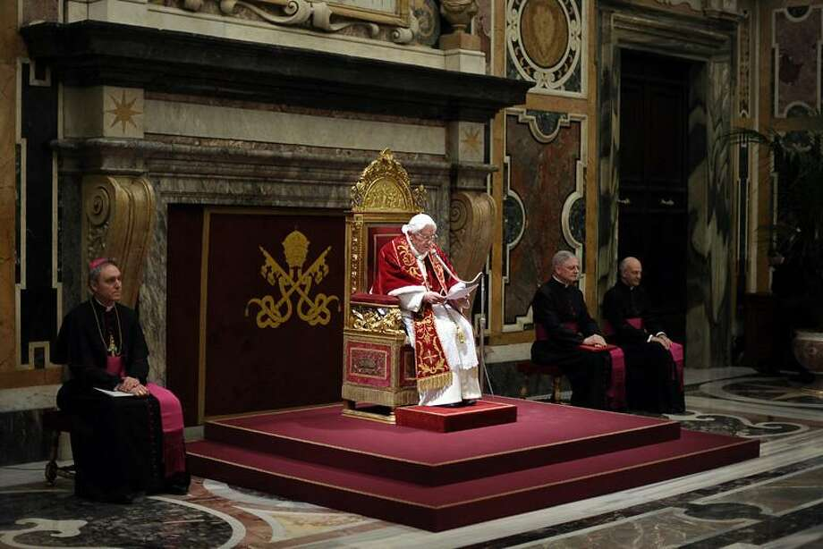 """This handout picture released by the Vatican Press Office on February 28, 2013 shows Pope Benedict XVI (C) delivering a speech to cardinals in the Vatican's ornate Clementine Hall at the Vatican. Pope Benedict XVI vowed """"unconditional obedience"""" to his successor on his historic final day as leader of the world's 1.2 billion Catholics, when he will become the first pontiff to resign since the Middle Ages. OSSERVATORE ROMANO""""-/AFP/Getty Images"""