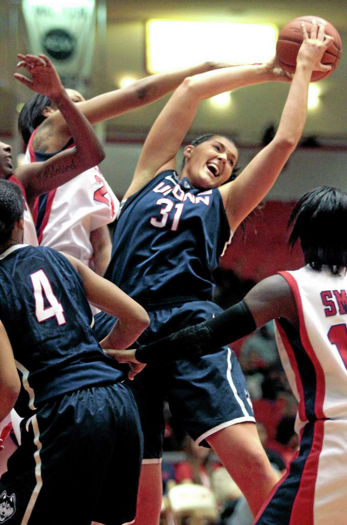 UConn center Stefanie Dolson brings down a rebound during the first half of the No. 1 Huskies' 92-41 win at Houston on Saturday.