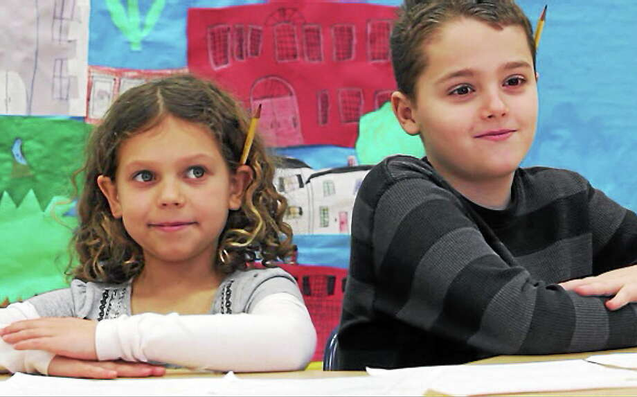 Litchfield Center School students Cheyanne Fortier, 8, and Ethan Rogozinsky, 9, film one of the school's daily news programs Monday. Photo: Shako Liu—Register Citizen