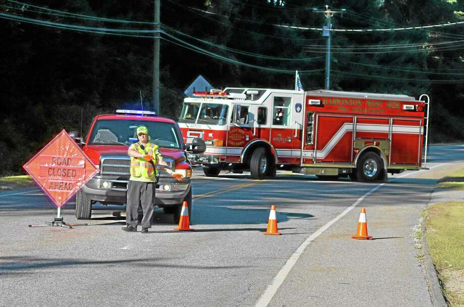 Route 118 in Harwinton was closed for a short time Sunday evening following an accident where a car struck a bicyclist near the road's intersection with Route 222. Photo: Mercy Quaye—Register Citizen