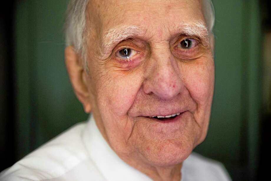 In this May 27, 2014 photo, World War II veteran Richard 'Bert' King, 89, poses for a portrait at his home in Ambler, Pa. King took part in the D-Day invasion on June 6, 1944. Memories of King's wartime service came in fragments during an interview with The Associate Press. He recalled dodging German subs on the nausea-inducing voyage to Europe, a trip he called 'the worst 10 days of my life.' (AP Photo/Matt Rourke) Photo: AP / AP