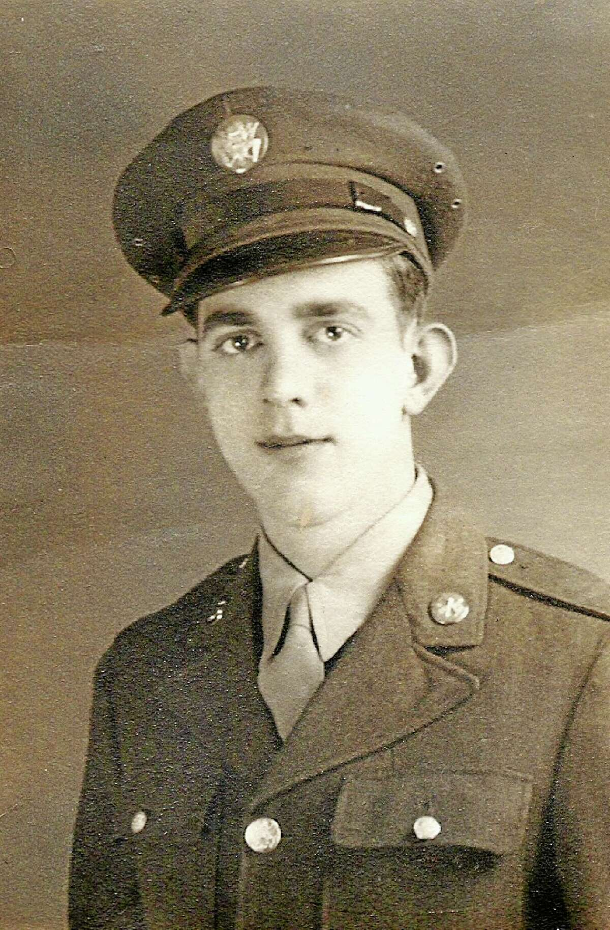 In this 1940s era photo provided by and shown is World War II veteran Richard 'Bert' King. King took part in the D-Day invasion on June 6, 1944. Memories of King's wartime service came in fragments during an interview with The Associate Press. He recalled dodging German subs on the nausea-inducing voyage to Europe, a trip he called 'the worst 10 days of my life.' (AP Photo/Richard King)