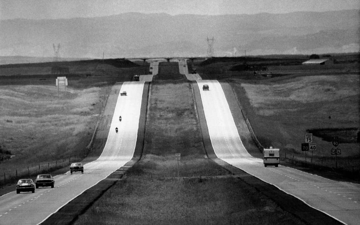 In this Sept. 8, 1972 file photo, cars pass by on Interstate 90, into the Black Hills in Murdo, S.D. After rising continuously since World War II, driving by American households has declined nearly 10 percent since 2004. (AP Photo/File)