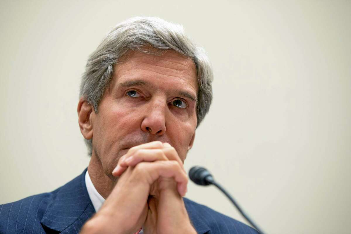 Secretary of State John Kerry pauses prior to testifying on Capitol Hill in Washington, Wednesday, Sept. 4, 2013, before a House Foreign Affairs Committee hearing on Syria.