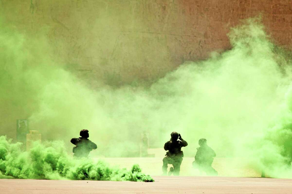 FILE - In this Thursday, June 20, 2013 file photo, soldiers participate in a combined special operations demonstration with commandos from Jordan, Iraq and the U.S. as part of Eager Lion multinational military maneuvers, at the King Abdullah Special Operations Training Center (KASOTC) in Amman, Jordan. The White House soon may sign off on a project to train and equip moderate Syrian rebel forces, according to Obama administration officials. The move would significantly boost U.S. support for rebels seeking military help to oust Syrian President Bashar Assad. President Barack Obama is considering sending a limited number of American troops to Jordan to be part of a regional training mission that would instruct carefully screened members of the Free Syrian Army on tactics, including counterterrorism operations, the officials said.(AP Photo/Maya Alleruzzo, File)