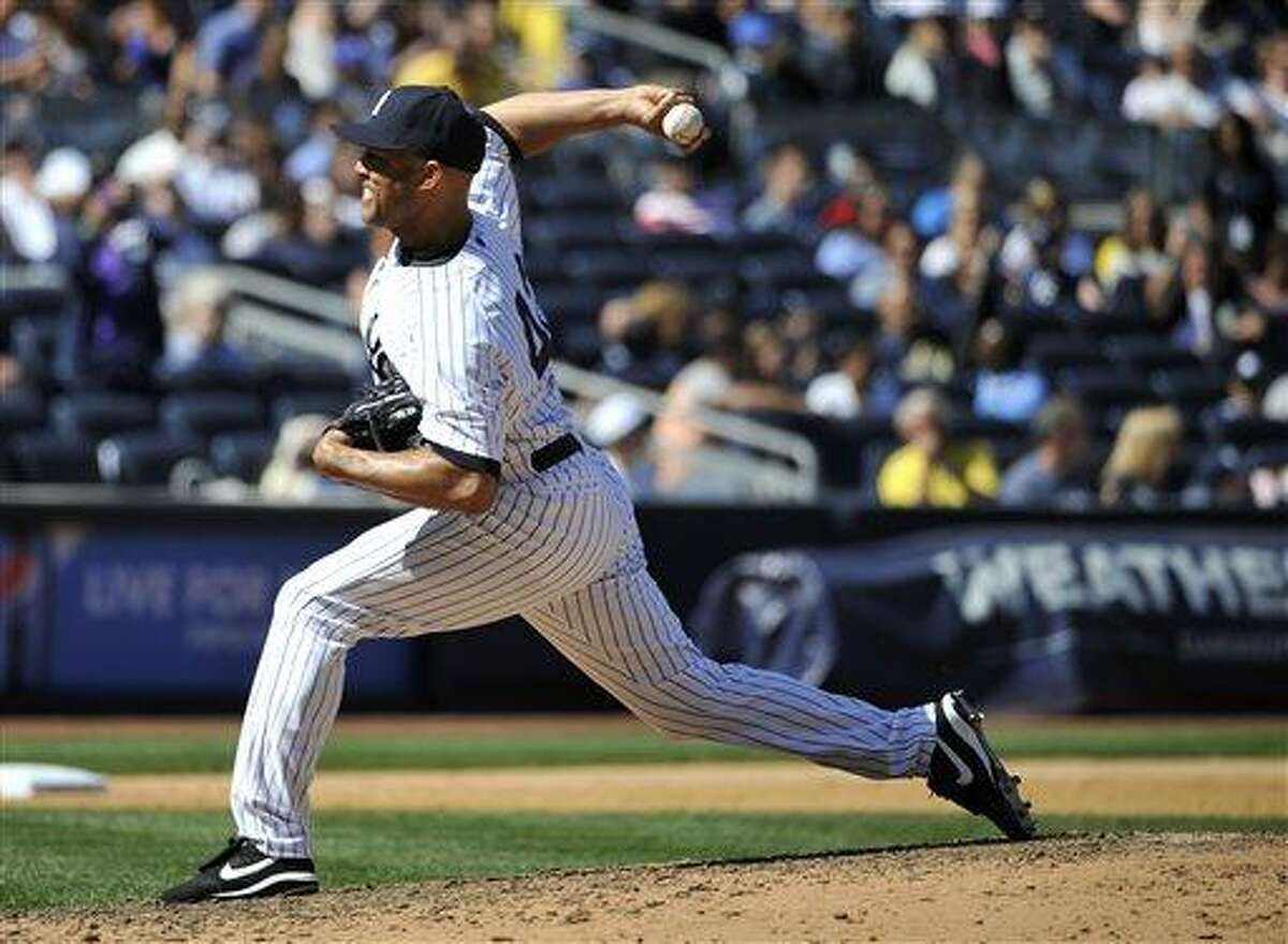 New York Yankees relief pitcher Mariano Rivera throws against he Oakland Athletics in the ninth inning of a baseball game at Yankee Stadium on Saturday, May 4, 2013, in New York. The Yankees won 4-2. (AP Photo/Kathy Kmonicek)