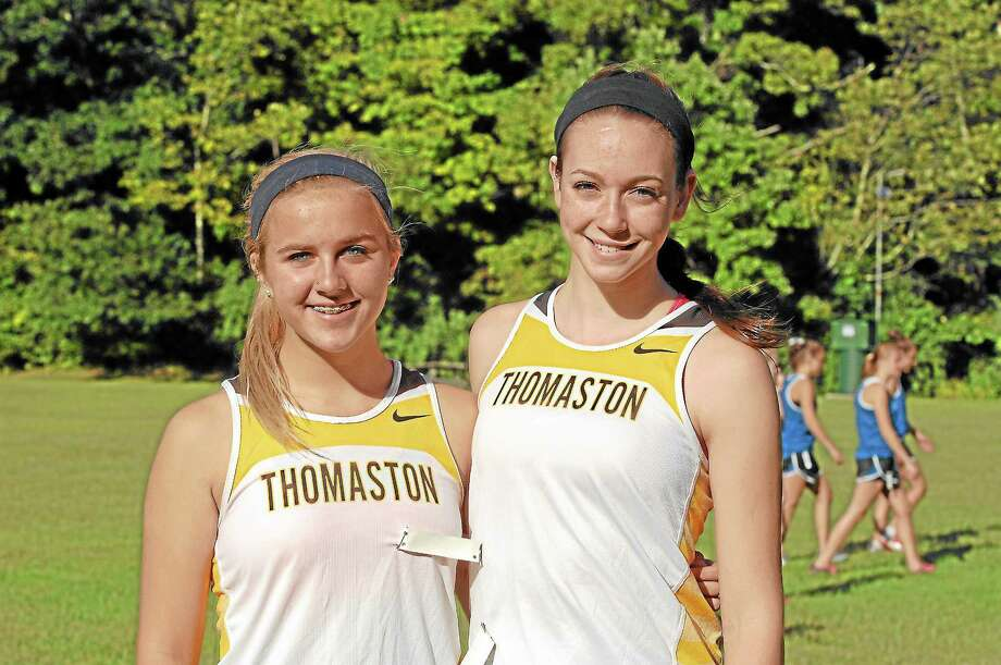 Both Sabrina Olsen, left, and Becky Perugini, right, will play important roles for the Thomaston Golden Bears girls cross country team this season. Photo: Laurie Gaboardi — Register Citizen
