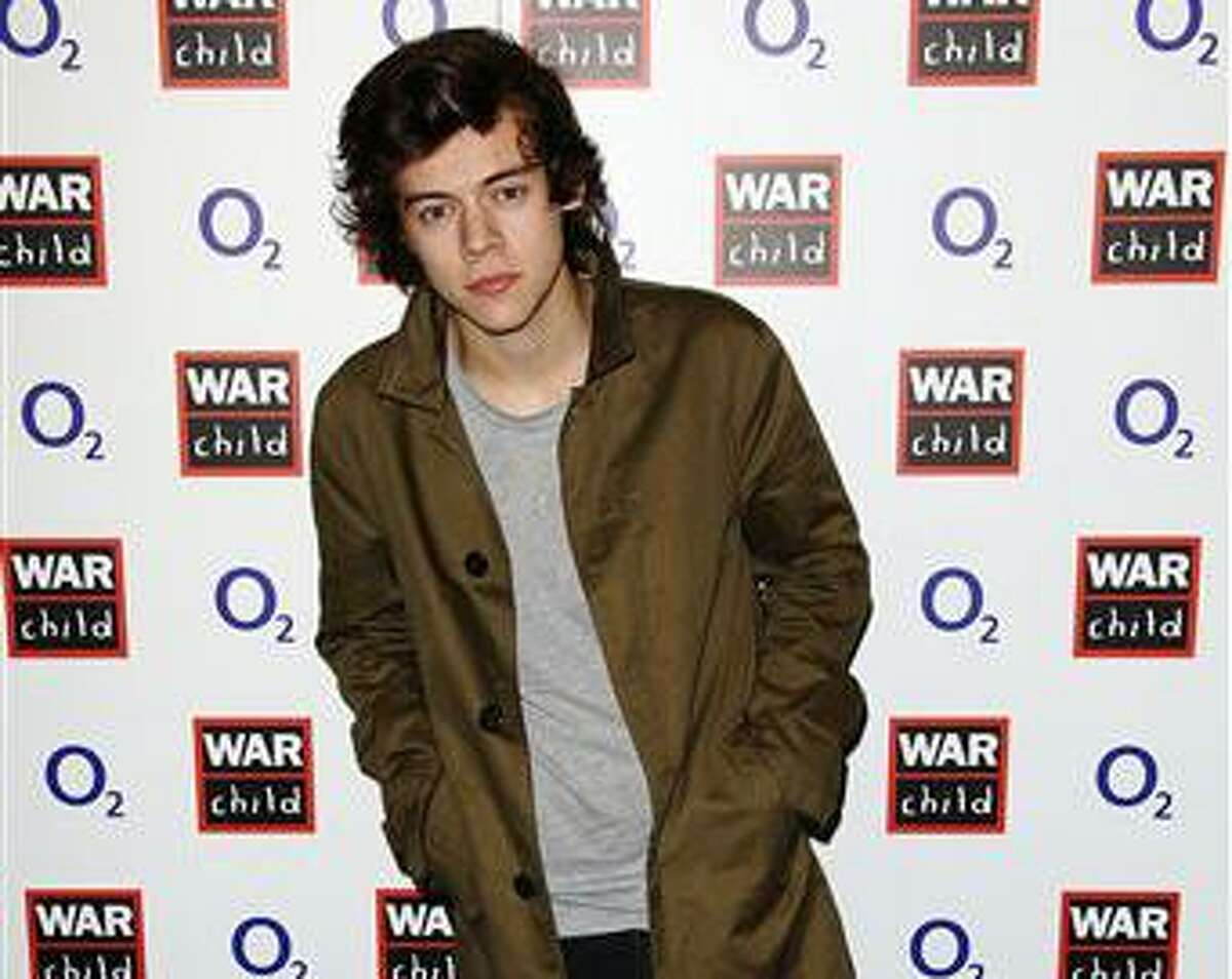 Harry Styles poses for a photograph at the O2 and War Child BRIT Awards Concert with Muse at O2 Shepherds Bush Empire on Monday, Feb. 18, 2013, in London. (Photo by Jon Furniss Photography/Invision/AP)