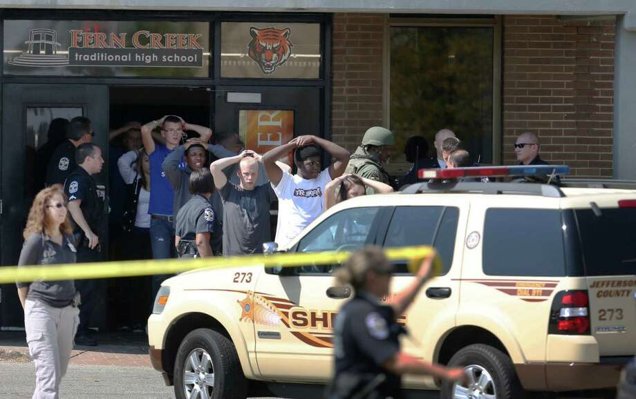 Students put their hands on their heads as they are lead out of Fern Creek High School in Louisville, Ky. on Tuesday, Sept. 30 2014 after a shooting. Photo: Scott Utterback — The Courier-Journal — The Associated Press  / The Courier-Journal