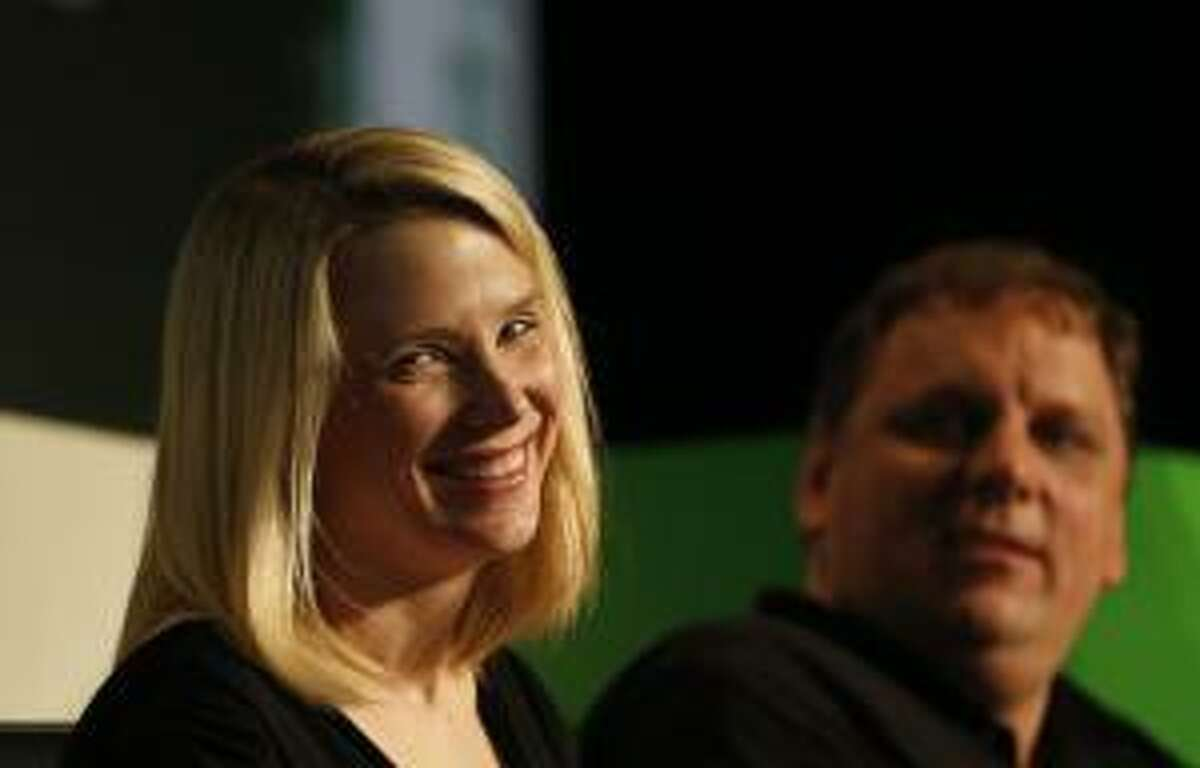 Yahoo! Chief Executive Marissa Mayer, left, smiles during a Startup Battlefield session at TechCrunch Disrupt SF 2012 in San Francisco. (Reuters/Stephen Lam)