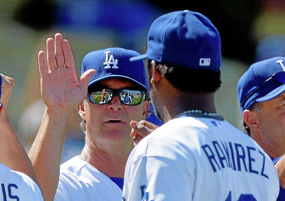 Dodgers manager Don Mattingly, left, congratulates Hanley Ramirez after Los Angeles beat the Chicago Cubs 4-0 on Wednesday in Los Angeles.