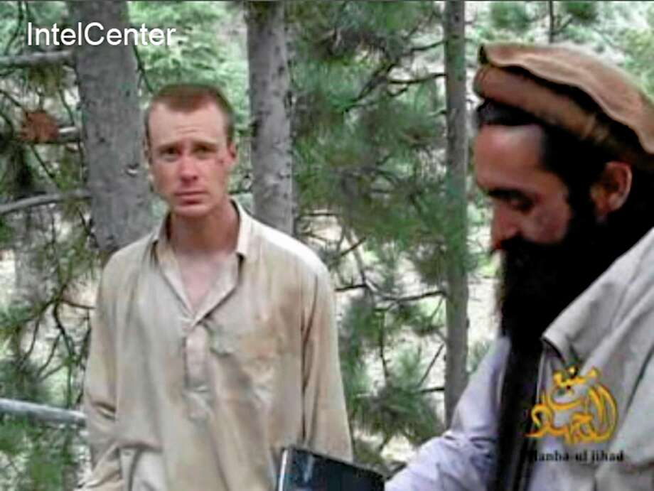 This file image provided by IntelCenter on Dec. 8, 2010, shows a frame grab from a video released by the Taliban containing footage of a man believed to be Bowe Bergdahl, left.  Saturday, May 31, 2014, U.S. officials say Bergdahl, the only American soldier held prisoner in Afghanistan has been freed and is in U.S. custody. The officials say his release was part of a negotiation that includes the release of five Afghan detainees held in the U.S. prison at Guantanamo Bay, Cuba. Photo: AP File Photo/IntelCenter  / Intel Center