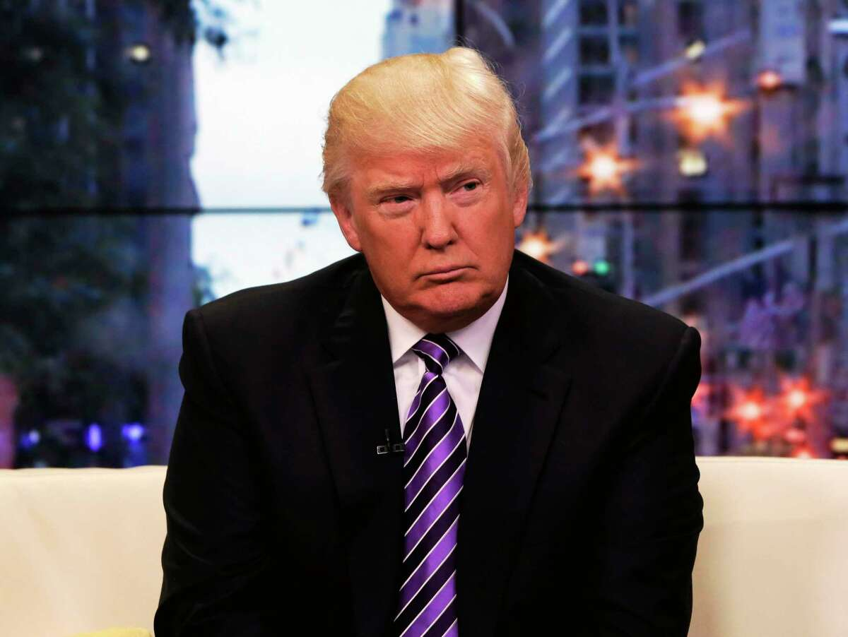 """This Sept. 16, 2013 photo, Donald Trump appears on the """"Fox & friends"""" television program in New York."""